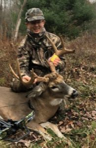 crossbow kills big buck - youth hunter with big buck